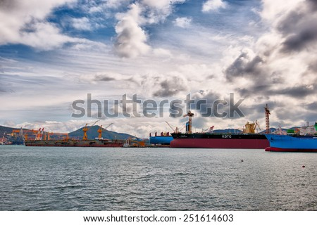 Geoje, South Korea - 11 February 2014:  Vessel's from oil tankers to cargo ships sit in the ship building yard at DSME. - stock photo
