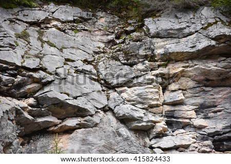 Geological fault in a limestone rock wall - stock photo