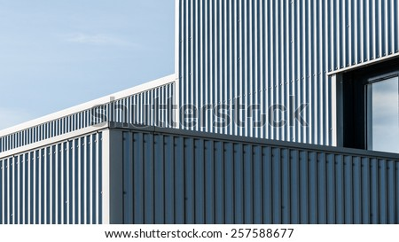 geometric architectural lines of an industrial building - stock photo