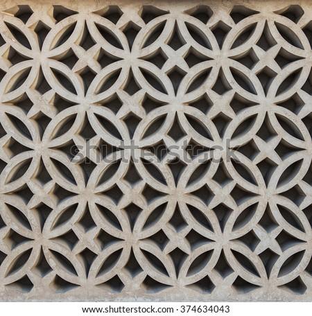 Geometric design pattern on grill. Decorative wall cladding. - stock photo