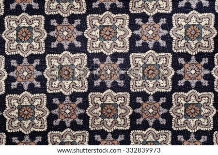 Geometric pattern embroidered on fabric - stock photo