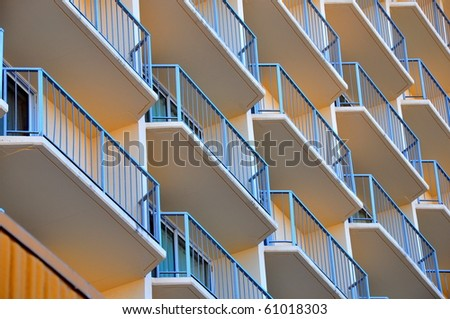 Geometric patterned balconies of a hotel. - stock photo