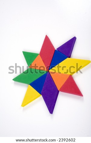 Geometric star made from children's learning foam toy set. - stock photo