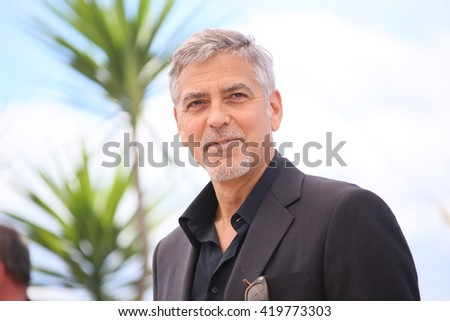 George Clooney attends the 'Money Monster' photocall during the 69th annual Cannes Film Festival at the Palais des Festivals on May 12, 2016 in Cannes, France. - stock photo