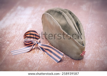 George Ribbon and garrison cap with a red star. On the anniversary of the 70 anniversary of the victory in World War II - stock photo