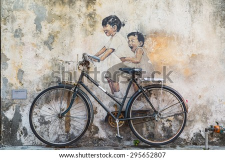 GEORGE TOWN,PENANG ,MALAYSIA- CIRCA March 26, 2015: Public street art Name Children on a bicycle painted 3D on the wall that's two little  Chinese girls riding bicycle in Georgetown, Penang, Malaysia. - stock photo