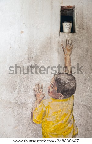 GEORGE TOWN,PENANG ,MALAYSIA- March 26, 2015: Public street art Name Street Mural entitled Reaching Up on the wall by Ernest Zacharevic in Georgetown, Penang, Malaysia. - stock photo