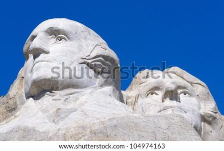 George Washington and Thomas Jefferson faces on Mount Rushmore National Memorial - stock photo