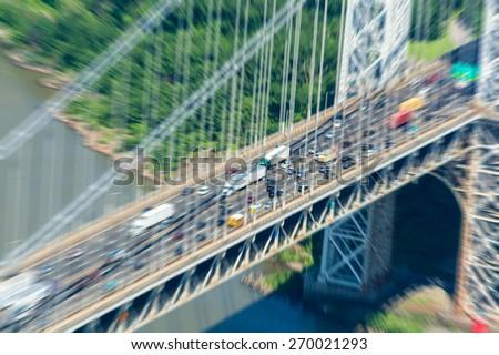 George Washington Bridge. Blurred aerial view view of New York City. - stock photo