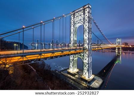 George Washington Bridge fully illuminated at dusk  - stock photo