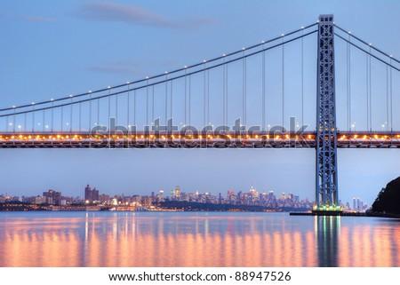 George Washington Bridge with NYC skyline at dusk - stock photo