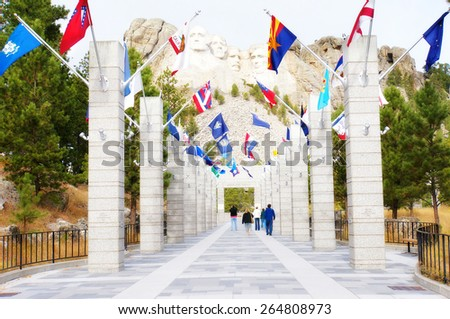 George Washington, Thomas Jefferson, Theodore Roosevelt and Abraham Lincoln and the flags of the States at Mt. Rushmore National Memorial, Keystone, South Dakota, US - stock photo