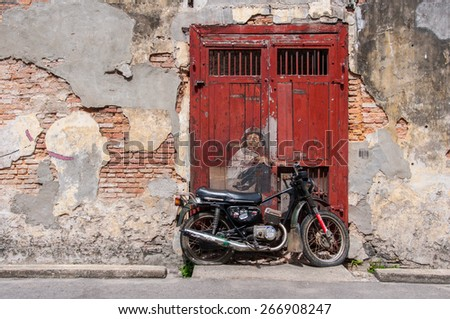 """Georgetown, Penang, Malaysia - February 19, 2015: """"Little Boy With Pet Dinosaur"""" street art on wall by Lithuanian artist Ernest Zacharevic in George Town, Penang, Malaysia. - stock photo"""