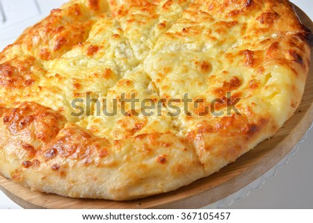 Georgian cuisine - khachapuri with cheese - stock photo