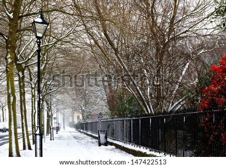 Georgian houses in traditional winter snow scene - stock photo