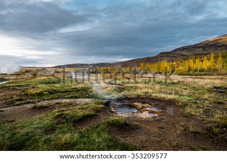 Geothermal geysir. Icelandic pool with a hot water. Hydrogen sulfide steam. Hot spring. - stock photo