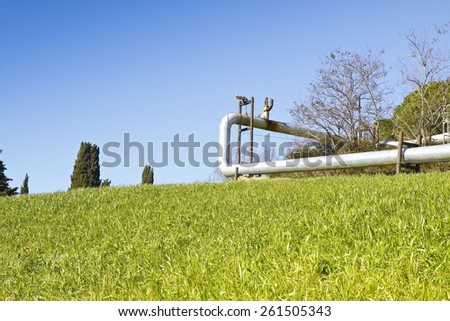 Geothermal power plant in Tuscany hills with copy space - stock photo