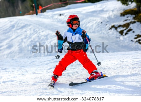 GERARDMER, FRANCE - FEB 16 - French kid form ski school groups during the annual winter school holiday on Feb 16, 2015 in Gerardmer, France. - stock photo