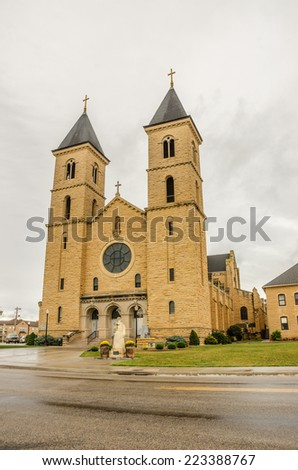 German and German Russian Catholics erected St. Fidelis Church from 1908-1911 using native limestone.  It is now in the National Register of Historic Places for its architectural significance. - stock photo
