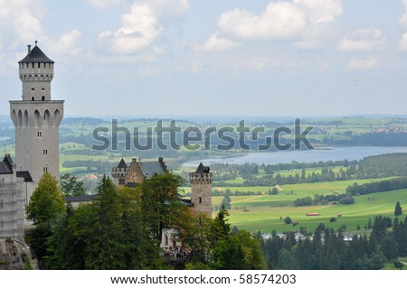 German Castle Neuschwanstein with view of Bavaria - stock photo