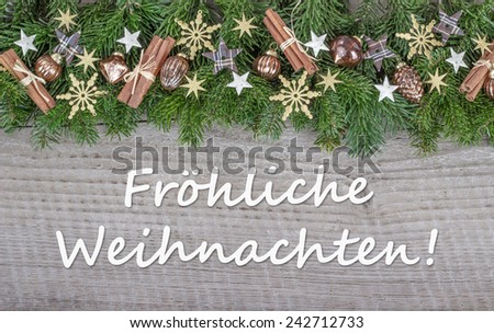 german Christmas card  with Christmas baubles, fir branches, stars and text Merry Christmas/Merry Christmas/german - stock photo
