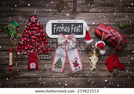 German christmas greeting card with rustic decoration in red: Merry Xmas - stock photo