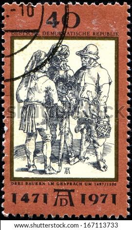 "GERMAN DEMOCRATIC REPUBLIC - CIRCA 1971: A stamp by the German Democratic Republic Post shows  ""Talk of three peasants"" by Albrecht Durer,  circa 1971  - stock photo"