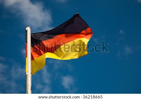 German flag against blue sky - stock photo