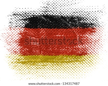 German flag on dotted surface - stock photo