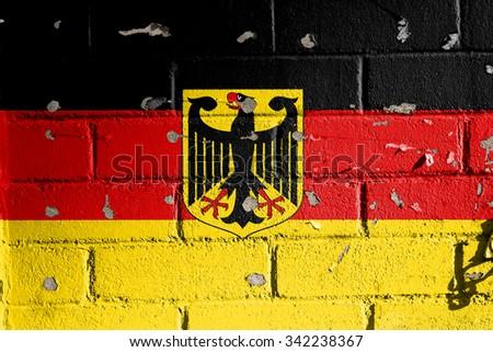 German flag painted brick wall. - stock photo