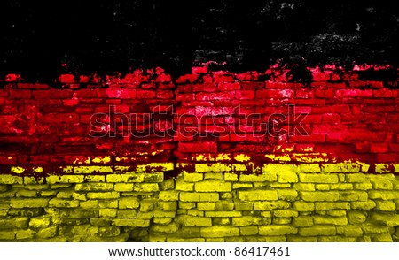 German flag painted on old brick wall - stock photo