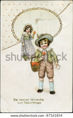 "German greeting postcard, ""Best wishes to the birthday!"", depicts a boy and a girl with flowers, circa 1905 - stock photo"