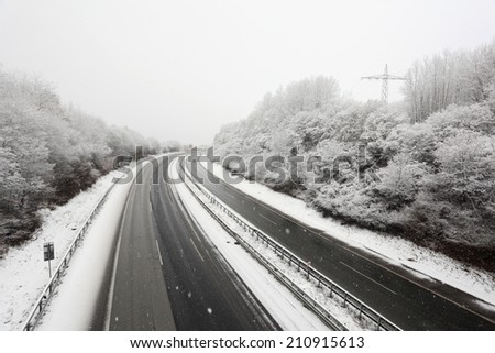 German highway during a heavy snowstorm in winter - stock photo