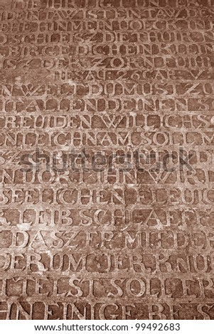 German inscriptions on medieval stone surface from crusaders stronghold - stock photo