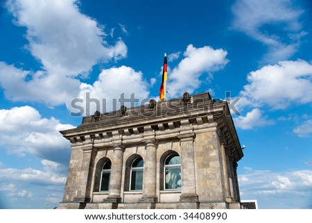 German national flag against blue sky in outdoor - stock photo