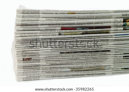German newspaper stack on white background - stock photo