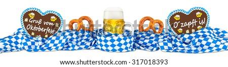 german oktoberfest beer mug gingerbread hearts and pretzel in bavarian flag - stock photo