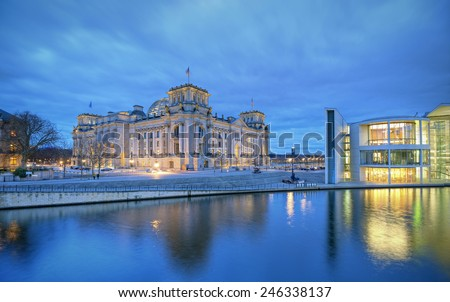 German parliament building (Reichstag) and river Sprew at evening, Parliament district, Berlin, Germany, Europe - stock photo