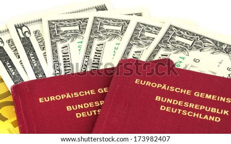 German passport with some banknotes isolated on white - stock photo