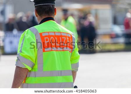 german policeman on a street  - stock photo