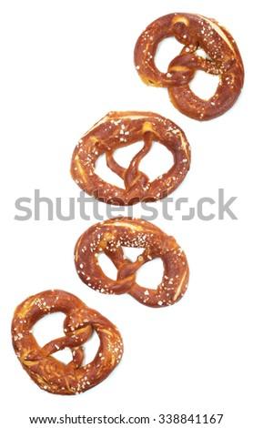 German pretzel sprinkled with coarse sea salt, isolated on white background - stock photo