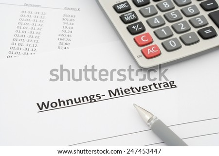 german rental agreement - Mietvertrag Wohnung - in german with calculator and pen - stock photo