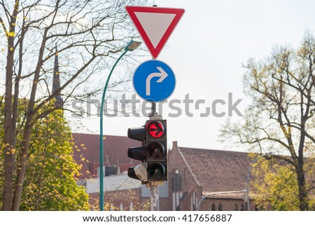 german traffic light on a crossing - stock photo