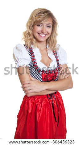 German woman with crossed arms in a traditional bavarian dirndl - stock photo