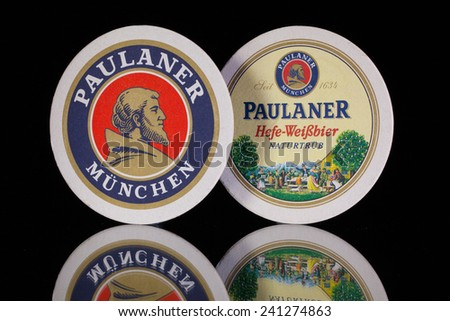 Germany,Berlin -December 12,2014:Beermats from Paulaner beer.Paulaner is a German brewery, established in 1634 in Munich by the Minim friars of the Neudeck ob der Au cloister. - stock photo