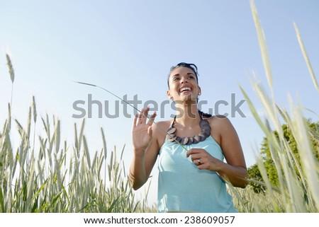 Germany, Brandenburg, young happy woman in grain field - stock photo