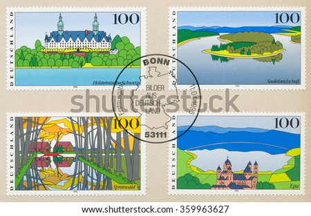 GERMANY - CIRCA 1996: A first day of issue postmark printed in Bonn, shows Holstein Switzerland, Saale, Spreewald, Eifel, circa 1996 - stock photo