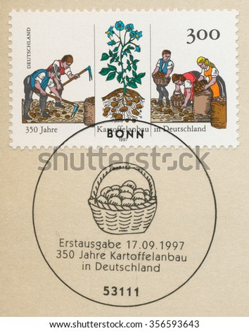 GERMANY - CIRCA 1997: A first day of issue postmark printed in Germany, shows Cultivation of Potatoes in Germany, 350th Anniv., circa 1997 - stock photo