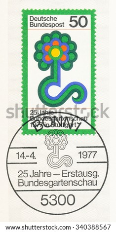 GERMANY - CIRCA 1977: A  first day of issue postmark printed in Germany, shows Flower Show Emblem, 25th Federal Horticultural Show, Stuttgart, Apr. 29-Oct. 23., circa 1977 - stock photo
