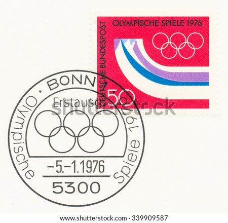 GERMANY - CIRCA 1976: A  first day of issue postmark printed in Germany, shows Olympic Rings, Symbolic Mountains, 12th Winter Olympic Games, Innsbruck, Austria, Feb. 4-15, circa 1976 - stock photo